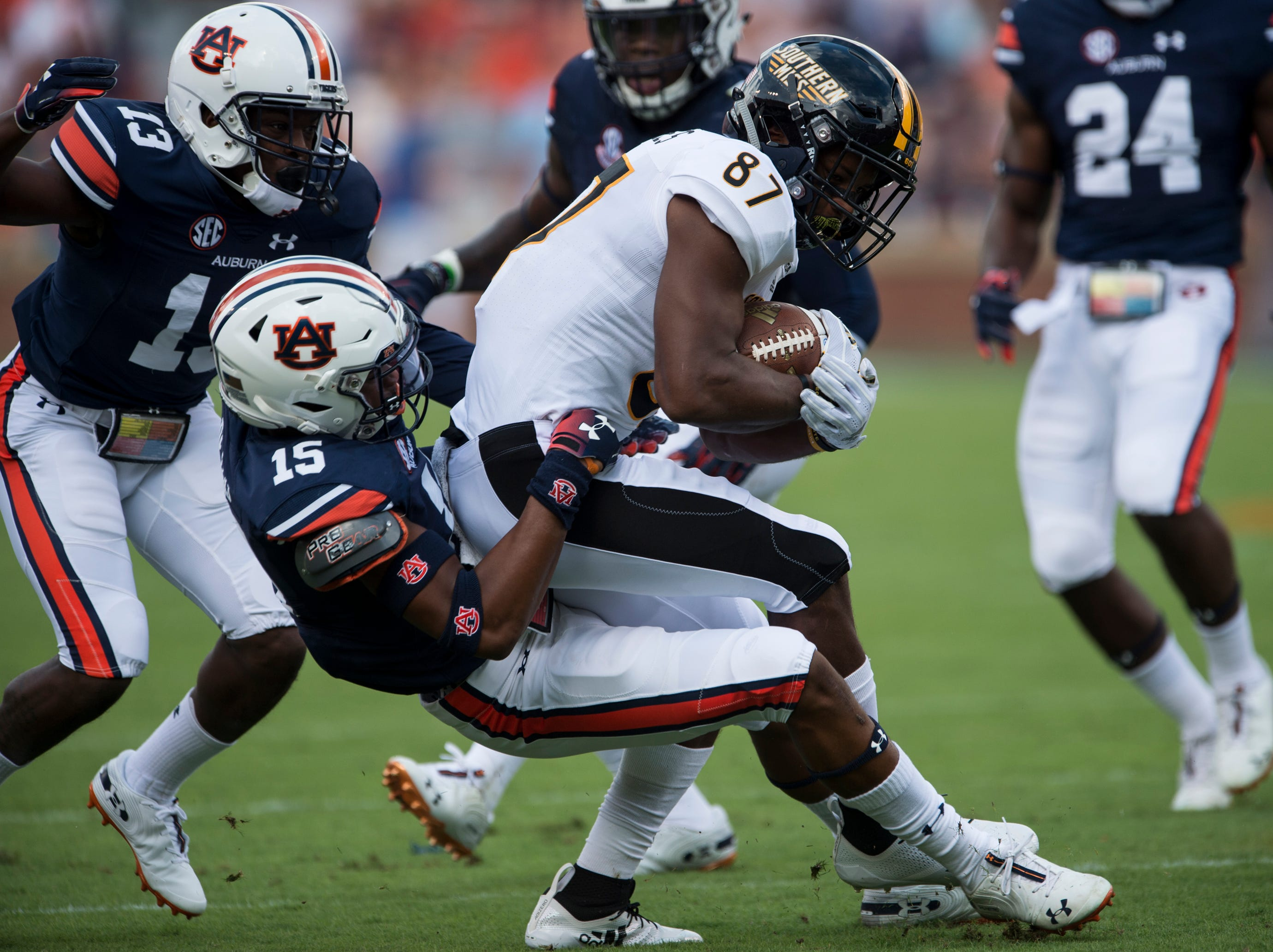 Auburn's Jordyn Peters (15) pulls down Southern Miss' Tim Jones (87) at Jordan-Hare Stadium in Auburn, Ala., on Saturday, Sept. 29, 2018. Auburn leads Southern Miss 14-3, the game went into a weather delay with 4:27 left in the second quarter.
