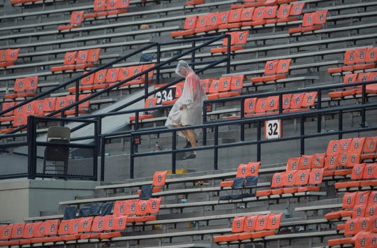 A lone fan in the stands at Jordan-Hare Stadium during a weather delay that interrupted a game between Auburn and Southern Miss on Saturday, Sept. 29, 2018.