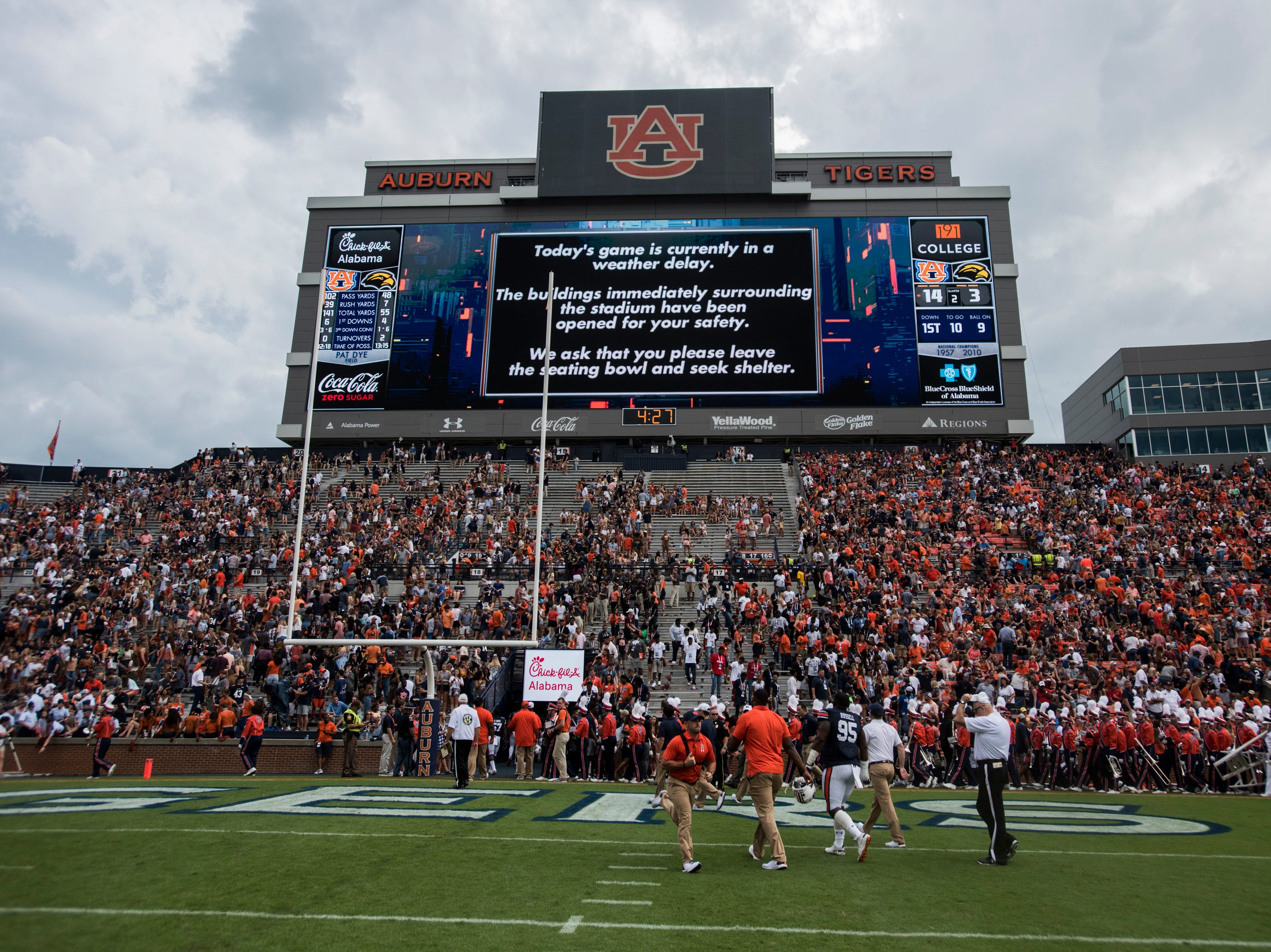 Auburn players head to the locker room after a weather delay is announced with 4:27 left in the second quarter of the Auburn-Southern Miss game at Jordan-Hare Stadium in Auburn, Ala., on Saturday, Sept. 29, 2018.