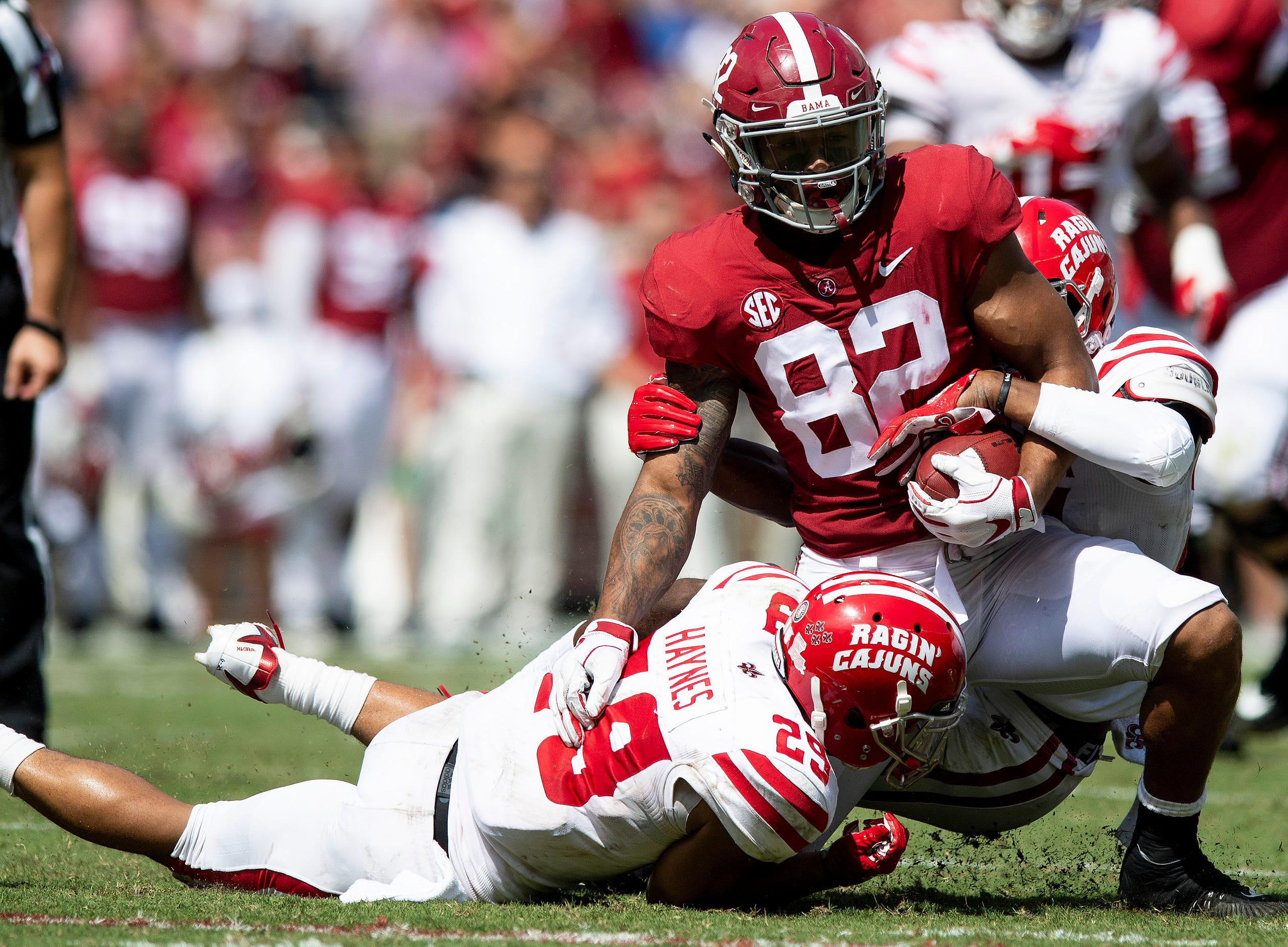 Alabama tight end Irv Smith Jr. (82) is tackled by Louisiana defensive back Koa Haynes (29) in first half action at Bryant-Denny Stadium in Tuscaloosa, Ala., on Saturday September 29, 2018.