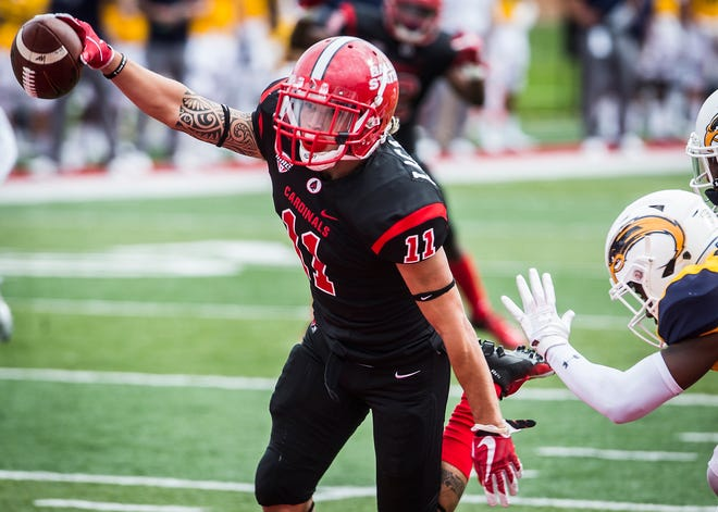 Ball State's Corey Lacanaria scores a touchdown against  Kent State's defense during their game at Scheumann Stadium Saturday, Sept. 29, 2018.