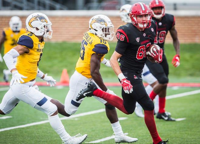 Ball State's Riley Miller catches a touchdown pass against Kent State at Scheumann Stadium Saturday, Sept. 29, 2018.