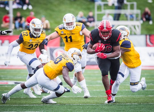 Ball State's Caleb Huntley fights through Kent State's defense during their game at Scheumann Stadium Saturday, Sept. 29, 2018.