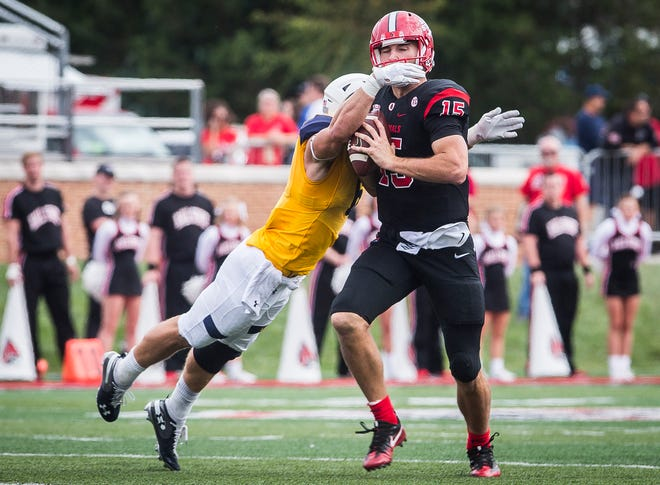 Ball State's Riley Neal looks to pass against Kent State's defense during their game at Scheumann Stadium Saturday, Sept. 29, 2018.