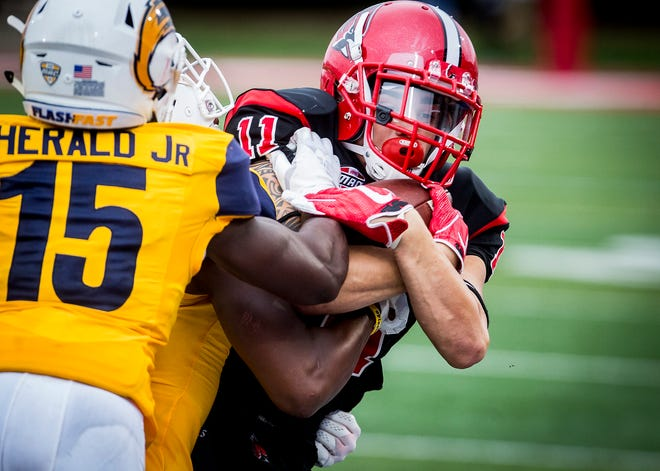 Ball State's Corey Lacanaria holds onto the ball against Kent State at Scheumann Stadium Saturday, Sept. 29, 2018.