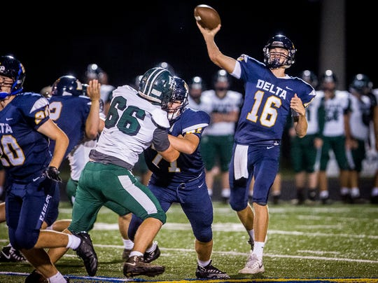 Delta's Brady Hunt throws against Pendleton Heights during their game at Delta High School Friday, Sept. 28, 2018.