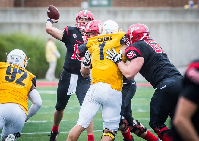 Ball State's Curtis Blackwell (62) and Danny Pinter block while Riley Neal passes against Kent State at Scheumann Stadium Saturday, Sept. 29, 2018.