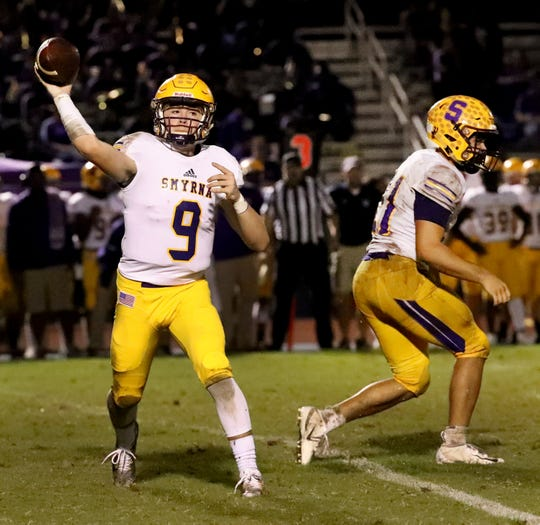 Smyrna quarterback Alex Bannister fires a pass during a recent game. The Bulldogs will finish no worse than second in 5-6A if they win out in the region.