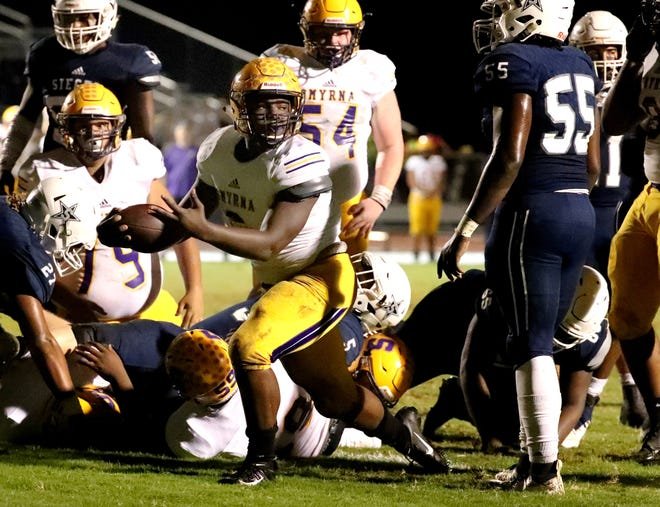 Smyrna's Mikel Hartfield looks to see if he crossed the goal line on a touchdown attempt Friday at Siegel. He scored a TD on the next play.