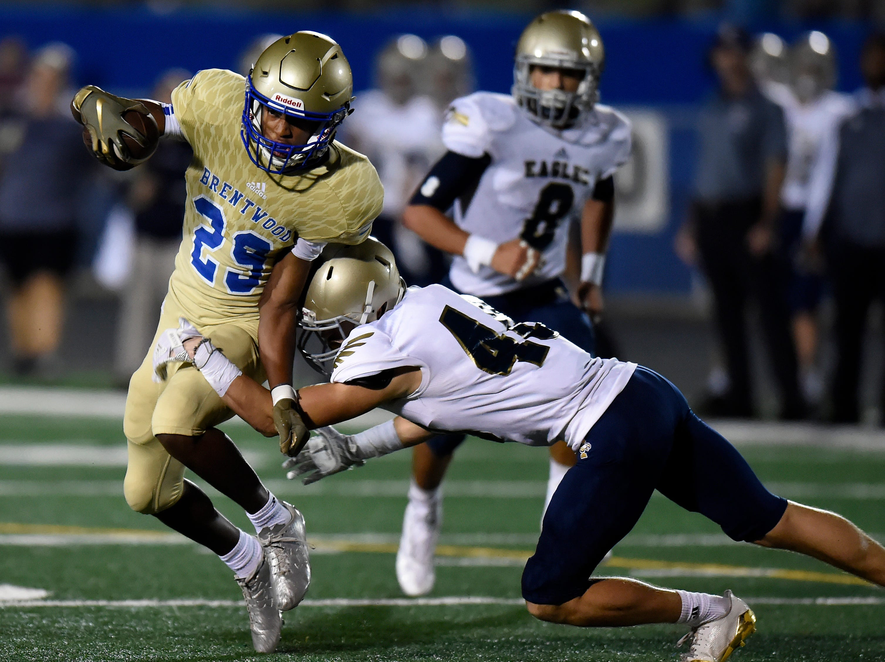 Brentwood running back Avery Williams (29) runs past Independence cornerback Brighan Morrical (40) during the second half of an high school football game Friday, September 28, 2018, in Brentwood, Tenn. Independence won 42-31.