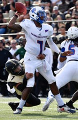 TSU quarterback Demry Croft (7) throws a pass as he is pressured by Vanderbilt linebacker Dimitri Moore on Saturday.
