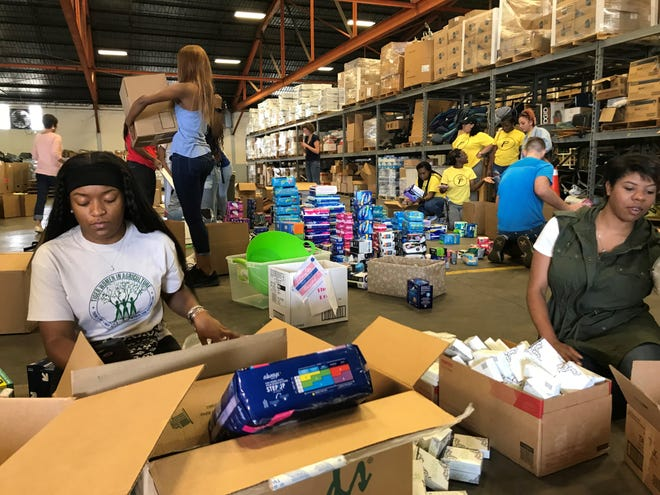 Period Project donations are sorted and counted on Saturday in a Metro Nashville Public Schools warehouse in South Nashville.