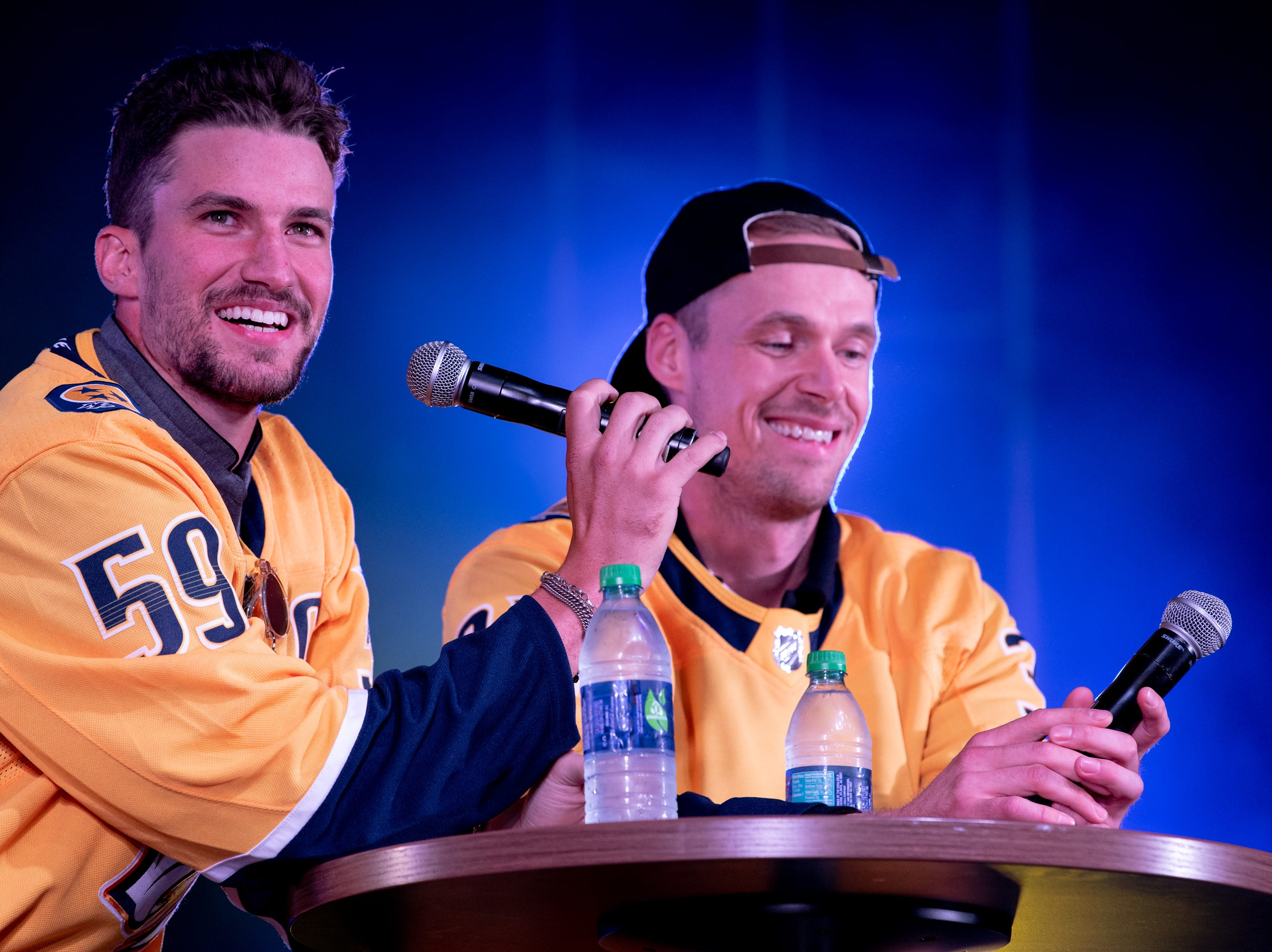 Nashville Predators defenseman Roman Josi (59) and goaltender Pekka Rinne (35) answer fan questions during the Player Gold Walk at the Bridestone Arena Walk of Fame Park in Nashville, Tenn., Friday, Sept. 28, 2018.