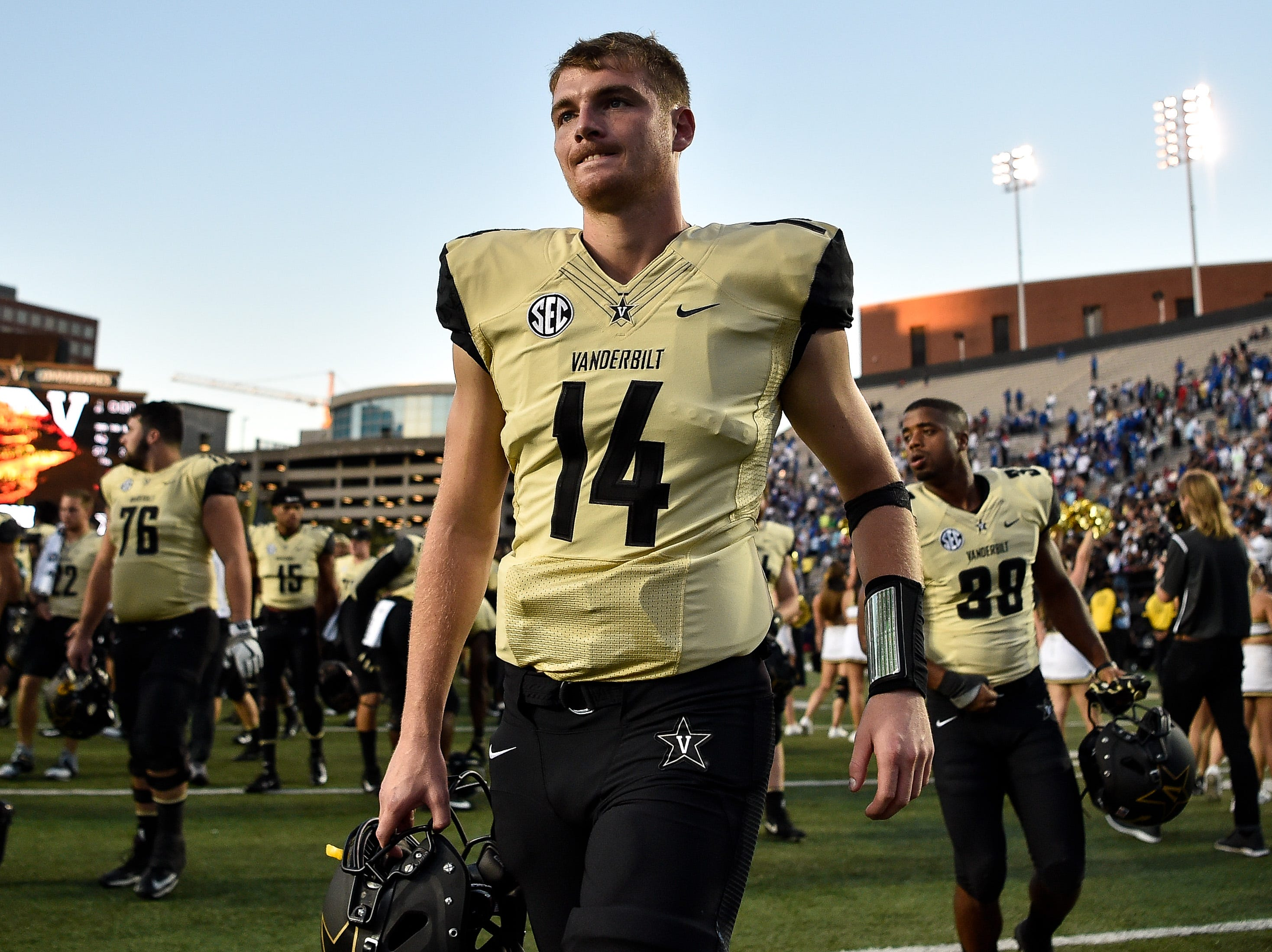 Vanderbilt quarterback Kyle Shurmur (14) exits the field after defeating TSU at Vanderbilt Stadium in Nashville, Tenn., Saturday, Sept. 29, 2018.