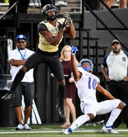 Vanderbilt wide receiver Kalija Lipscomb (16) makes a catch to score a touchdown next to TSU cornerback Dajour Nesbeth (10) during the second half at Vanderbilt Stadium in Nashville, Tenn., Saturday, Sept. 29, 2018.