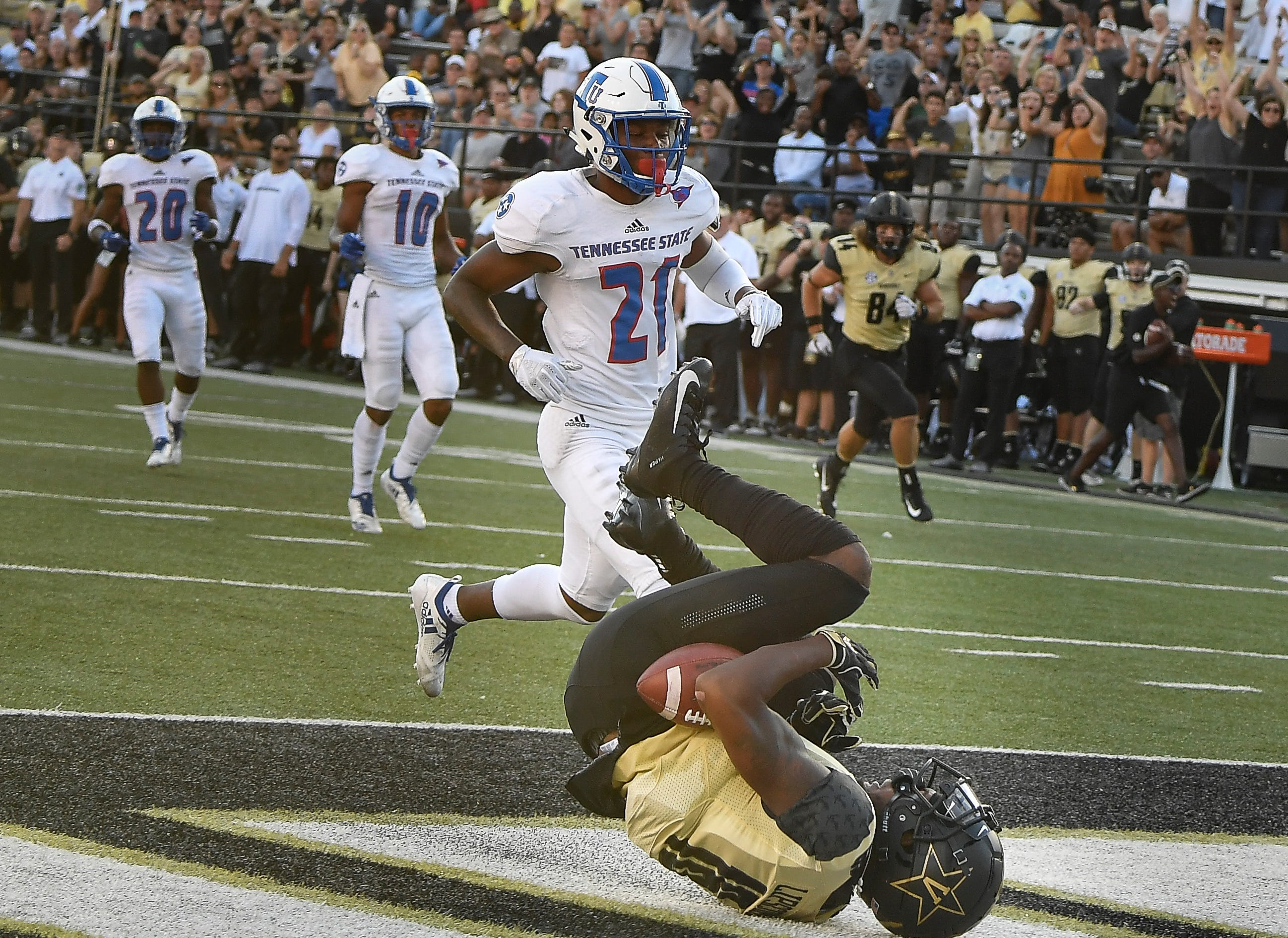 Vanderbilt wide receiver Kalija Lipscomb (16) falls into the end zone with a touchdown catch past TSU cornerback Neiman Armstrong (21) during the third quarter at Vanderbilt Stadium Saturday, Sept. 29, 2018, in Nashville, Tenn.