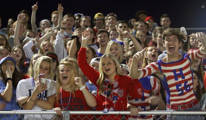 White House Heritage fans cheer on their team as they host Creek Wood on Friday, September 28, 2018.