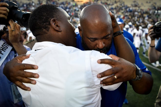 Vanderbilt coach Derek Mason hugs TSU coach Rod Reed after Vanderbilt's victory Saturday.