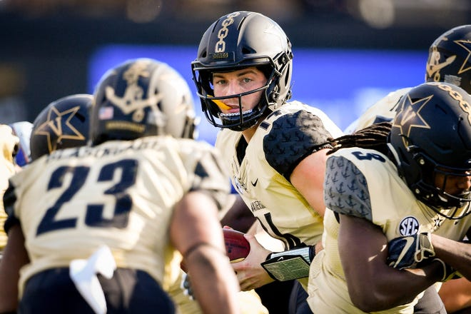Vanderbilt quarterback Kyle Shurmur (14) looks to handoff against TSU during the first half at Vanderbilt Stadium in Nashville, Tenn., Saturday, Sept. 29, 2018.