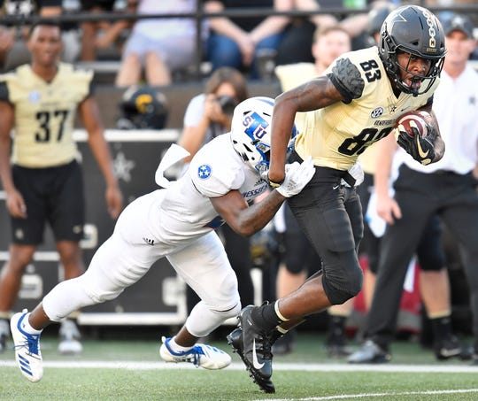 Vanderbilt wide receiver C.J. Bolar (83) tries to pull away from a TSU defender.