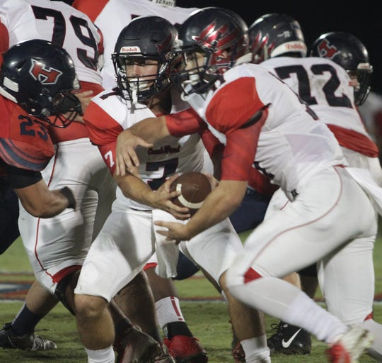 Creek Wood's Mitch Duke hands off to Danny Stansberry against White House Heritage on Friday, September 28, 2018.