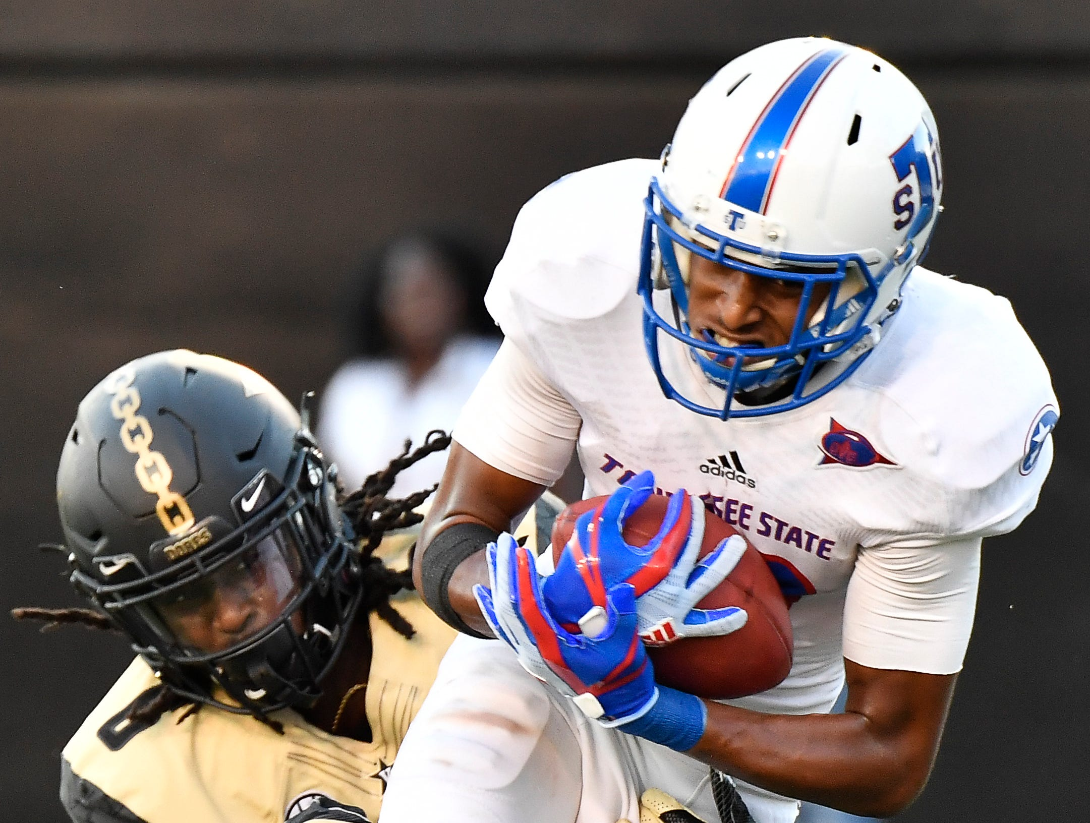 TSU wide receiver DeVon Johnson (13) pulls in a pass over Vanderbilt cornerback Joejuan Williams (8) during the fourth quarter Vanderbilt Stadium Saturday, Sept. 29, 2018, in Nashville, Tenn.