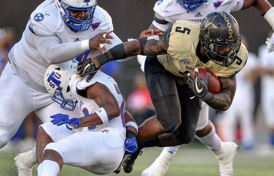 Vanderbilt running back Ke'Shawn Vaughn (5) battles TSU defensive tackle Khalil Jones (90) and defensive back Shakur Jackson (20) during the second half at Vanderbilt Stadium in Nashville, Tenn., Saturday, Sept. 29, 2018.