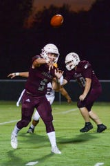 East Robertson High School player Cameron Swift passes the ball during a game against Trousdale County High School at East Robertson on Friday, Sept. 28.