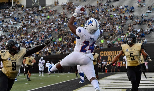 TSU running back Andrew Knox (24) pulls in a touchdown pass over Vanderbilt linebacker Caleb Peart (9) and safety LaDarius Wiley (5) during the fourth quarter of a game in 2018.