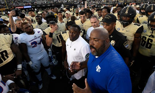 TSU head coach Rod Reed and Vanderbilt head coach Derek Mason explain the status of TSU linebacker Christion Abercrombie to their players at Vanderbilt Stadium Saturday, Sept. 29, 2018, in Nashville, Tenn. Abercrombie was taken to the hospital after suffering a head injury.