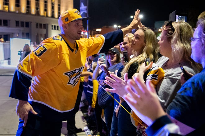 Predators forward Nick Bonino greets fans during the Gold Walk at Bridestone Arena on Sept. 28.