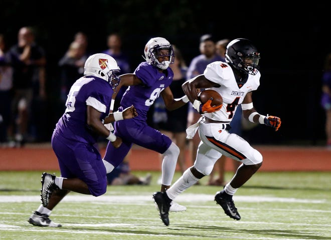 Ensworth's Keshawn Lawrence (4) outruns Father Ryan defenders for a touchdown  during their game Friday, Sept. 28, 2018, in Nashville, Tenn.