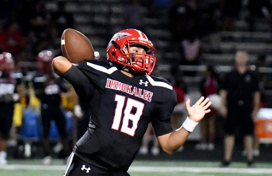 Immokalee quarterback R.J. Rosales attempts a pass during the Indians' game against Cypress Lake last season.
