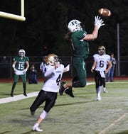 River Dell at Ramapo on Friday, September 28, 2018. R #9 Isaiah Savitt jumps to make a catch for a touchdown in the fourth quarter.