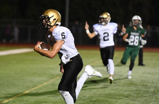 River Dell receiver Jack Racine (6), shown catching a touchdown at Ramapo earlier this season, made another TD grab in the Golden Hawks' playoff win over Pascack Valley on Friday.