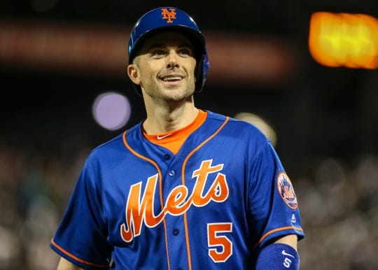 New York Mets third baseman David Wright (5) smiles at the fans after pinch hitting in the fifth inning against the Miami Marlins at Citi Field.