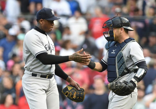 Sep 29, 2018; Boston, MA, USA; New York Yankees relief pitcher Aroldis Chapman (54) is congratulated by catcher Austin Romine (28) after defeating the Boston Red Sox at Fenway Park.