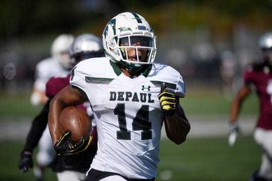 DePaul at St. Peter's Prep on Saturday, September 29, 2018. DP #14 Ronnie Hickman on his way to scoring a touchdown in the third quarter.
