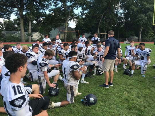 Coach Andy Howell addresses his Rutherford football team after the Bulldogs defeated Waldwick/Midland Park, 40-21, at Midland Park's Santorine Field on Saturday, Sept. 29, 2018.