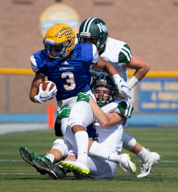 New Milford's defense converges on Lyndhurst's Ben Franchino (3) during the game at Lyndhurst on Saturday, Sept. 29, 2018. New Milford won the game in double overtime.