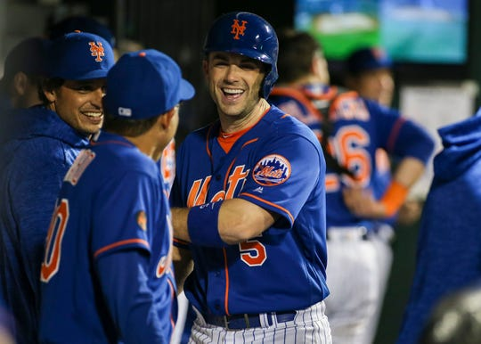 New York Mets third baseman David Wright (5) in the dugout in the fourth inning against the Miami Marlins at Citi Field.