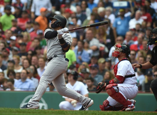 New York Yankees second baseman Gleyber Torres (25) hits a two run home run during the fourth inning against the Boston Red Sox at Fenway Park.