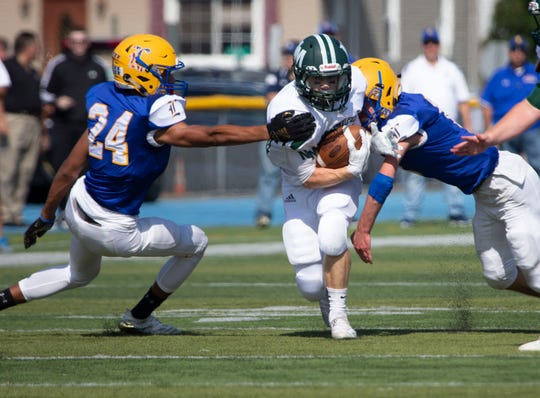 New Milford's Bart Nartivo (29) works on getting past the Lyndhurst defense during a game at Lyndhurst on Saturday, Sept. 29, 2018.