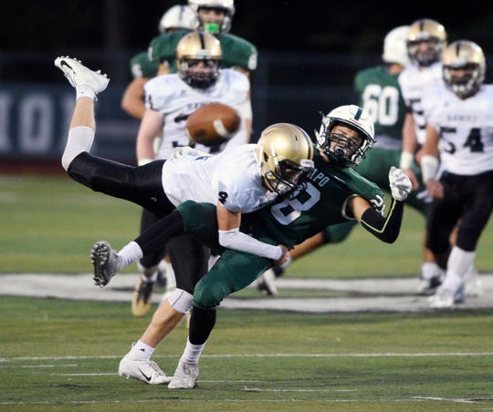 River Dell at Ramapo on Friday, September 28, 2018. RD #4 Mike Sirico brakes up a pass intended for R #28 Luke Robinson in the first quarter.