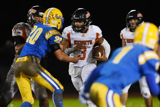 Butler's Jake Luciani (20) moving in to try to tackle Hasbrouck Heights' Jasiah Purdie (3) during their game at Butler on Friday, Sept. 28, 2018.
