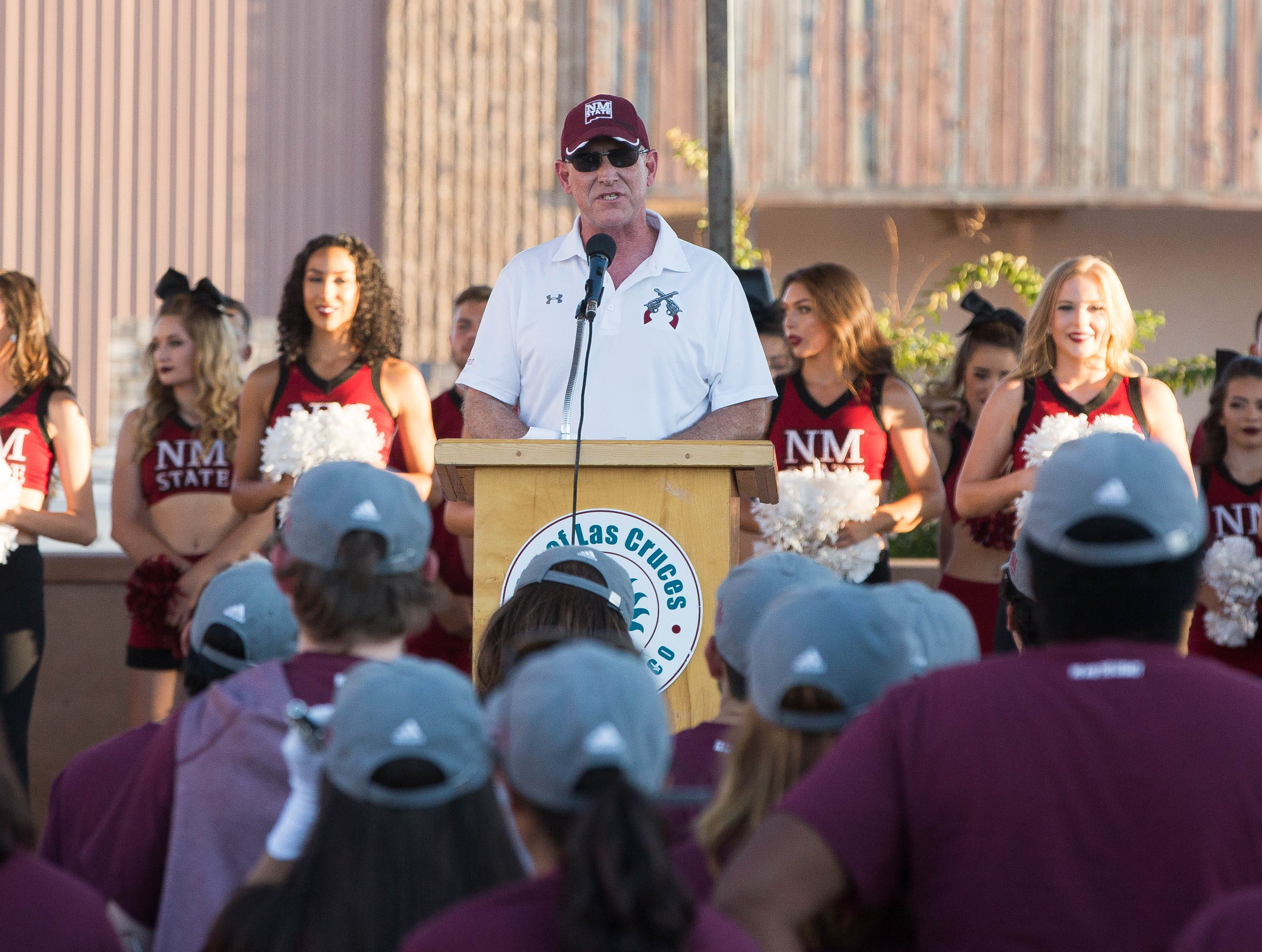 Stuart Ed, the Las Cruces City Manager, speaks to the Aggie fans and NMSU Athletes and Marching Band that gathered at the Plaza de Las Cruces for the Downtown Aggie Rally, Friday September 28, 2018.