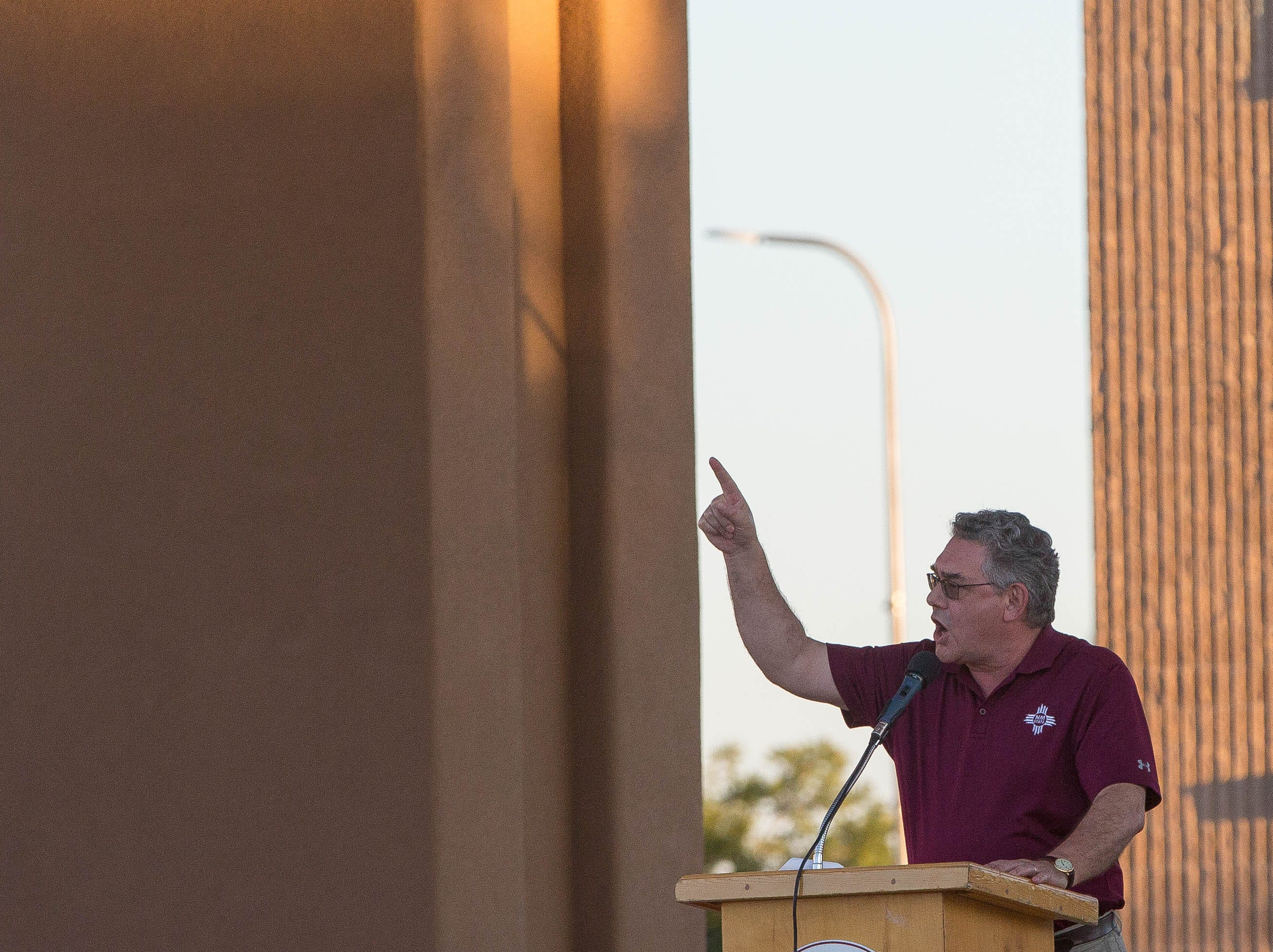 """John Flores, president of New Mexico State University leads the student athletes and Aggie fans in a chant of """"GO Aggies"""" during the Downtown Aggie Rally, Friday September 28, 2018 at the Plaza de Las Cruces."""
