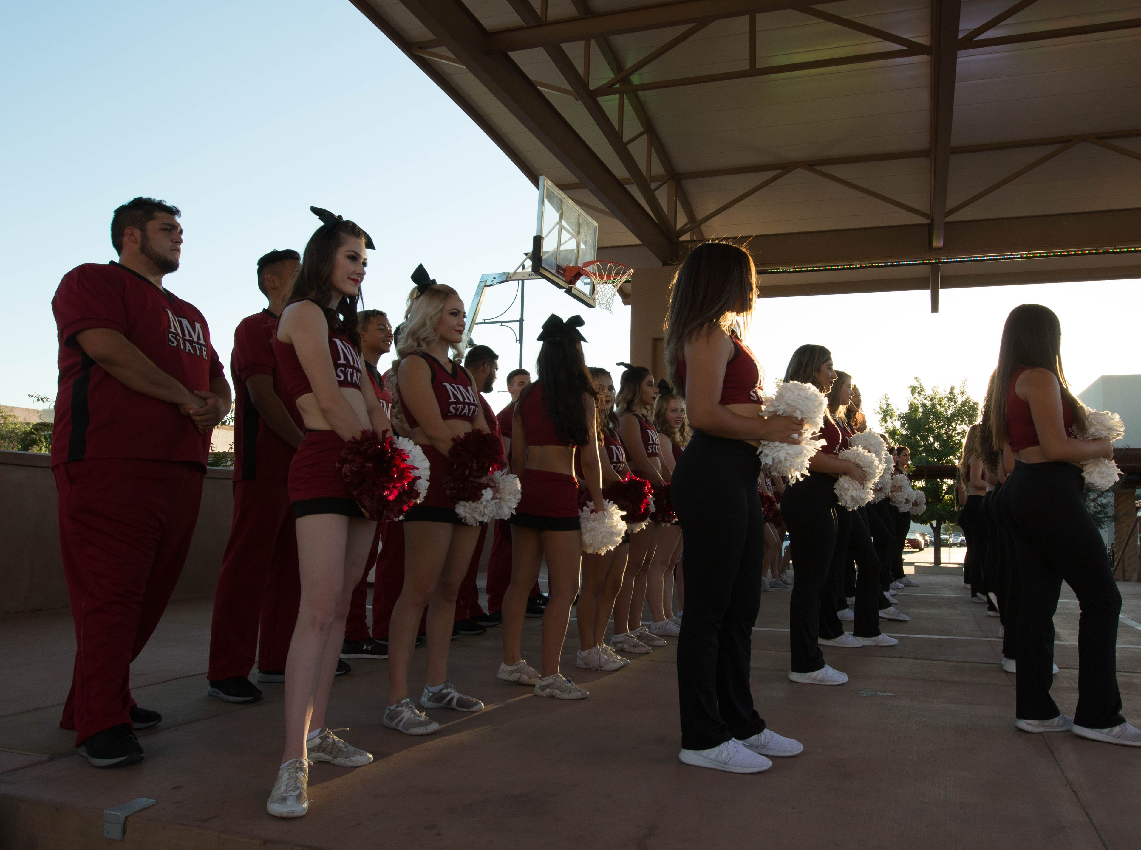 New Mexico State University Cheerleaders and Sun Dancers on stage while Las Cruces Mayor Ken Miyagishima speaks to the Aggie fans gathered  at the Plaza de Las Cruces during  the Downtown Aggie Rally, Friday September 28, 2018.