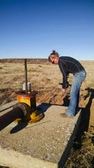 Kate Zeigler from Zeigler Geologic Consulting is monitoring groundwater at one of the sites of the research project. The research is focusing on working with farmers and ranchers to develop short- and long-term strategies that are proactive with the goal of maintaining ecological, social, and economic resilience in rural communities.