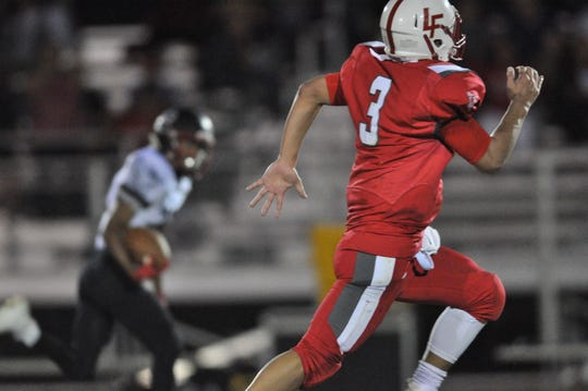 Falcon quarterback Kevin Gut-omen races to intercept a NMMI Colt in the second quarter following a fumble and long run that led to a Colt touchdown.